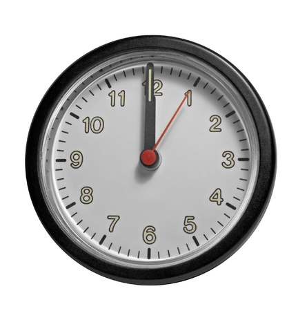 front end: studio photography of a clock showing past twelve ou00b4clock Stock Photo