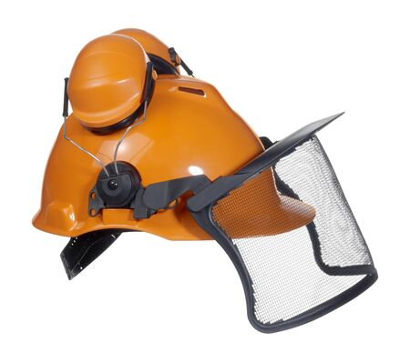 specific clothing: a orange protective helmet with ear- and face- protection. Studio shot in white back
