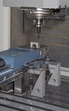 industrial workplace with millcut machine including milling head