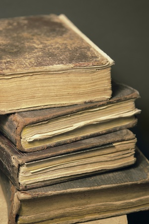 treatise: detail studio photography showing a stack of historic books Stock Photo
