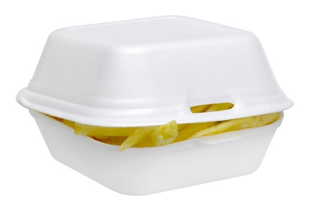 french fries in a white plastic box isolated on white photo