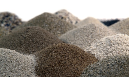 multicolored brown sand piles to one another