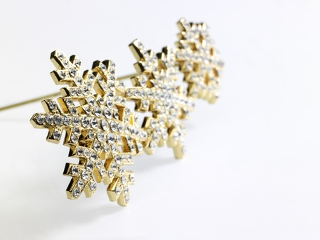 accouterment: studio shot of golden jewelry with diamonds in light back Stock Photo