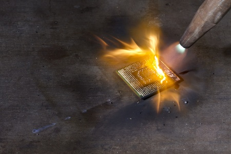 burning a central processing unit on metallic ground with welding torch Stock Photo - 11013843