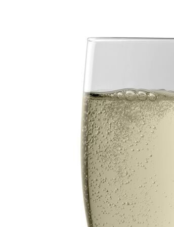 Studio photography showing the edge of a full champagne glass isolated on white with clipping path photo