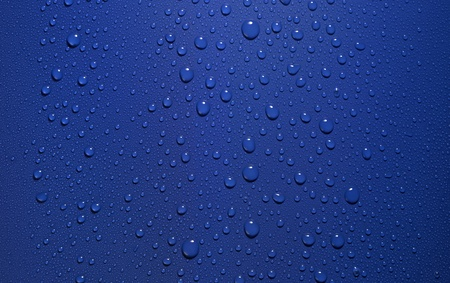 studio photography of roll-off water drops in blue back