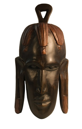 witchery: studio photography of a wooden african mask isolated on white