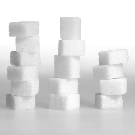 allegory painting: Studio photography of 3 lump sugar stacks in light gradient back