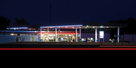 convenience store: illuminated service station near highway in Germany at late evening time