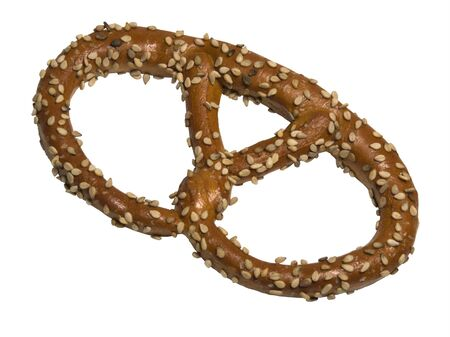 studio photography of a crisp sesame pretzel isolated on white Stock Photo - 11090020