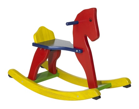 studio photography of a colorful wooden rocking horse in white back