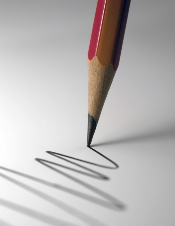 crayon: detail of a pencil tip while drawing a line in light back