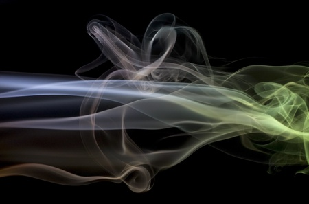 wavily: abstract picture showing some multicolored smoke in black back