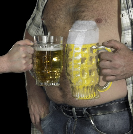 bodypainted man with belly and beer. Cheers! photo