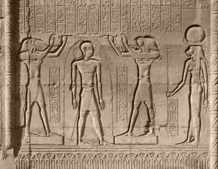 low relief: ancient stone relief at Chnum temple in Egypt in sunny ambiance