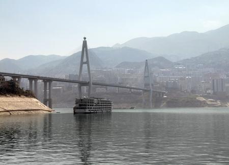 foggy scenery along the Yangtze River in China including bridge and tourist boat Stock Photo - 11094944