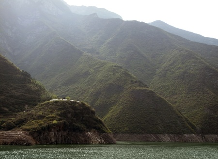 yangtze river: misty waterside scenery along the Yangtze River in China including overgrown mountains and hills