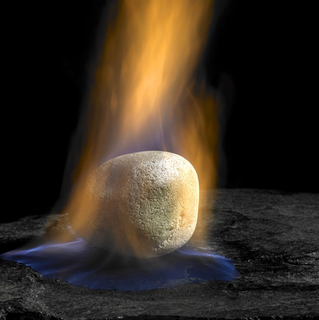 studio shot of a pebble and flames in dark back Stock Photo - 11095107