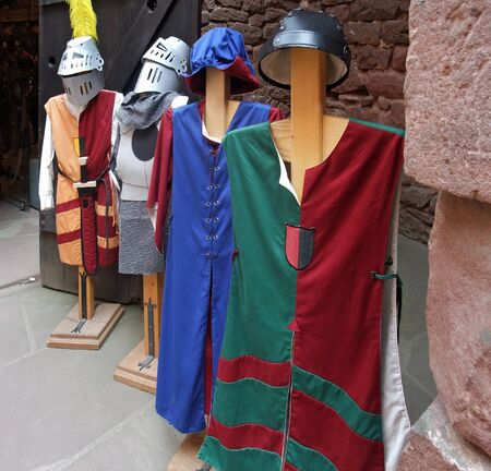 accouterment: some mediaeval styled tunics at a shop inside Haut-Koenigsbourg Castle in France