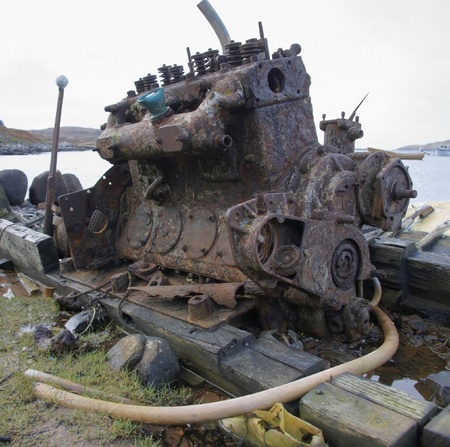 shipwreck: rotten old diesel engine at the coast in Scotland