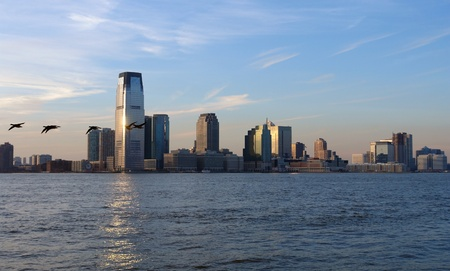 urbanized: city view of New Jersey (USA) and Hudson River at evening time