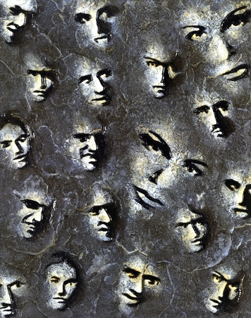 colored stone engraving done by me showing lots of modified faces photo