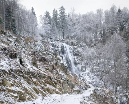 detail of a waterfall near Todtnau, a town in the Black Forest in Germany at winter time photo