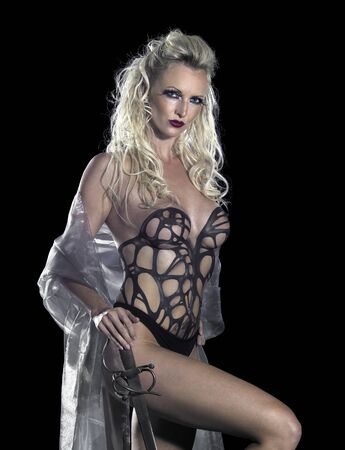 bodypainted blond woman posing in dark back and some fog photo