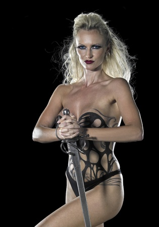 bodypainted blond woman posing in dark back and some fog Stock Photo - 11332420