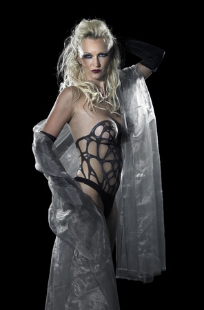 bodypainted blond woman posing in dark back photo