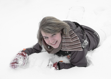 accouterment: winter scenery including a young girl playing with lots of snow Stock Photo