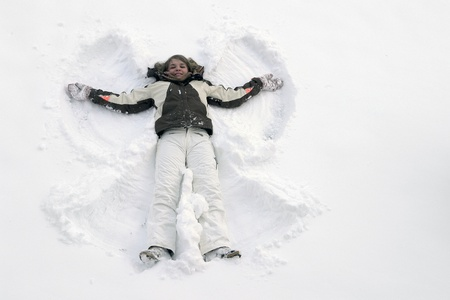 winter scenery: winter scenery including a young girl playing with lots of snow Stock Photo