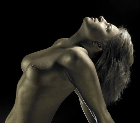studio photography of a golden bodypainted girl detail in black back Stock Photo - 11340848