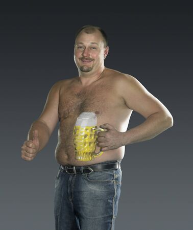 studio photography of a man with painted beer glass on his body in gradient back, signalling allright photo