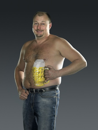 studio photography of a man with bodypainted beer glass on his body in gradient back photo