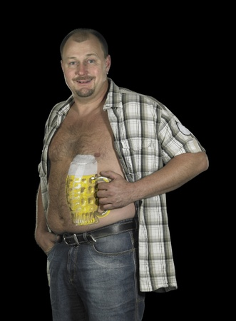 studio photography showing a man with painted beer glass on his body in dark back photo