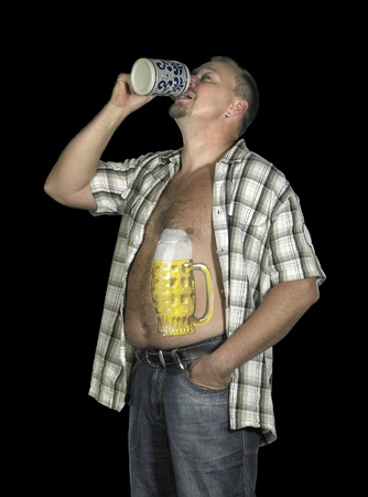 studio photography of a man with painted beer glass on his body while drinking from a beer mug, in dark back photo