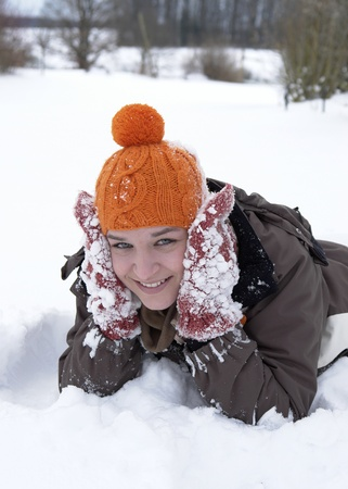 accouterment: a happy girl outdoor in winter ambiance