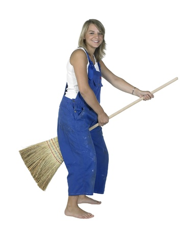 dirty blond: Studio photography of a blond girl dressed in a blue boilersuit while riding on a besom, isolated on white Stock Photo