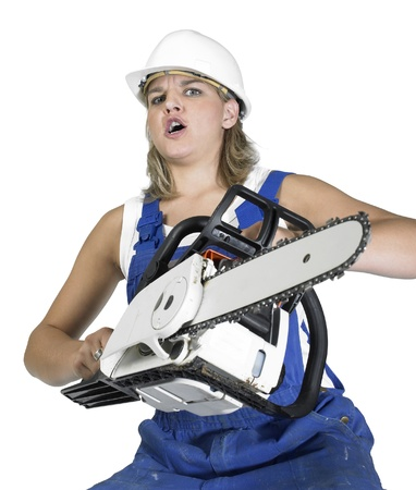 annihilate: angry militant girl with workwear, helmet and chain saw isolated on white Stock Photo