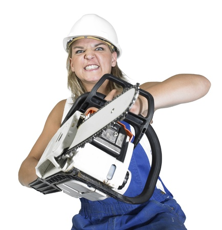 accouterment: Studio photography of a blond angry girl dressed in a blue boilersuit while attacking with a chain saw, isolated on white