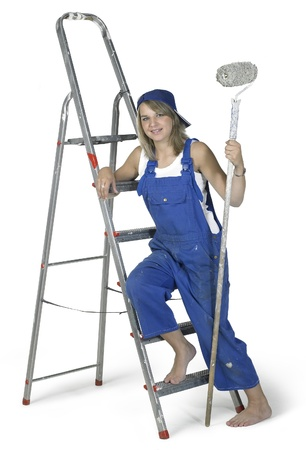 accouterment: Studio photography of a blond girl dressed in a blue boilersuit with painting utensils and ladderin white back