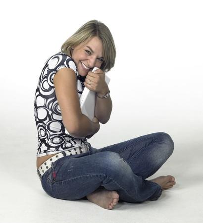 laughing  girl hugs her laptop  Reklamní fotografie