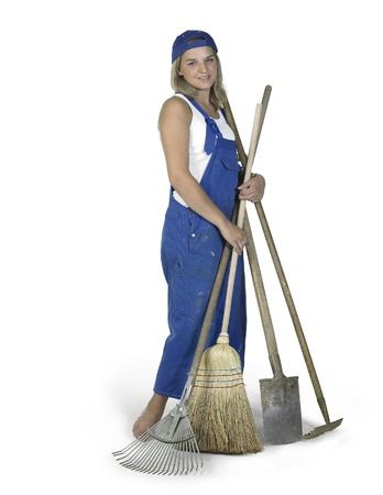 Studio photography of a blond girl dressed in a blue boilersuit with various gardening tools in white back Stock Photo - 11469288