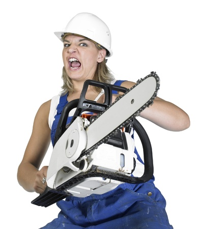 angry girl dressed in workwear with chain saw, isolated on white photo