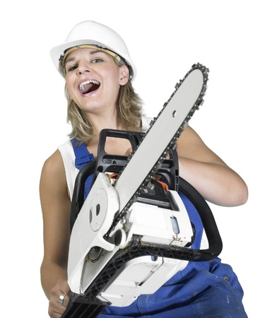 arrogant laughing girl dressed in workwear with chain saw, isolated on white photo