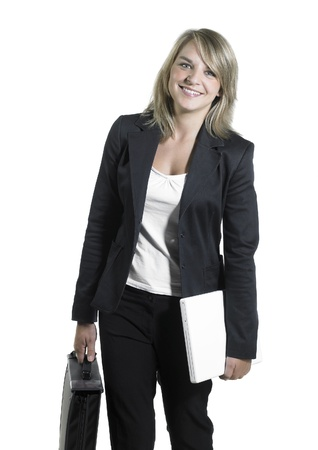 accouterment: Studio photography of a young smiling business woman with briefcase and laptop isolated on white