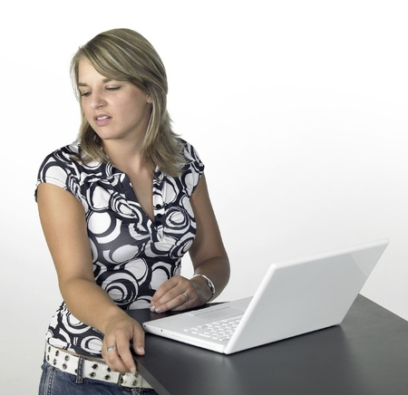 disgustedly girl with laptop in light back  photo