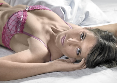 accouterment: lingerie dressed woman resting on bed