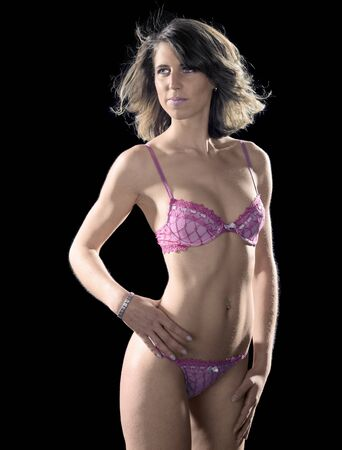 accouterment: pink lingerie dressed woman in black back